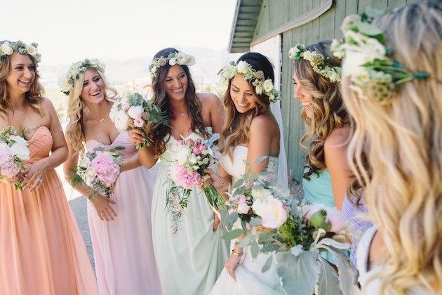 Bride with bridemaid's with floral accessories