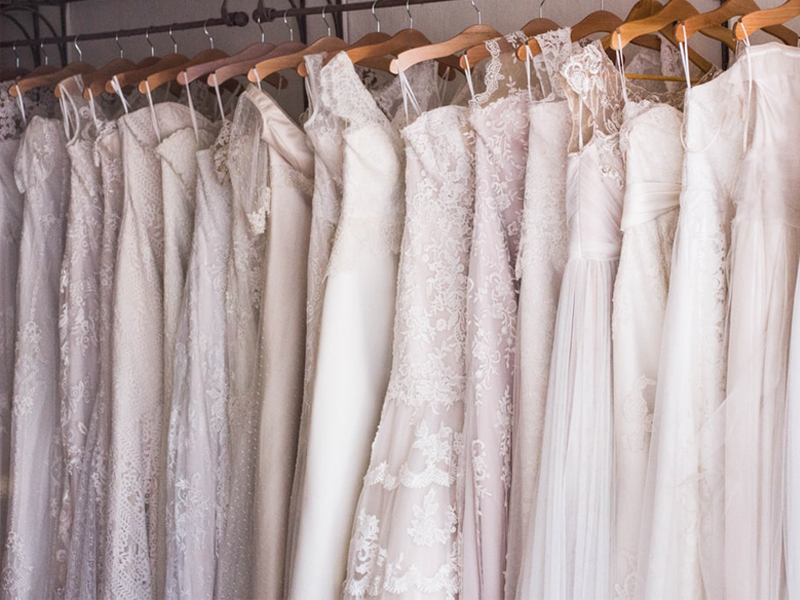 Wedding Dress Shopping - Wedding Dresses Hanging Up On Rack