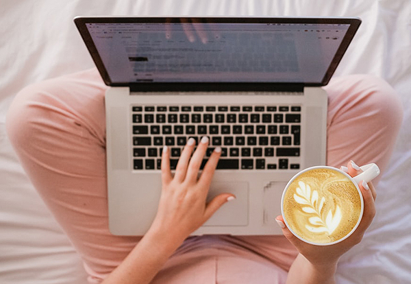 Wedding Registry - Woman On Laptop With Coffee
